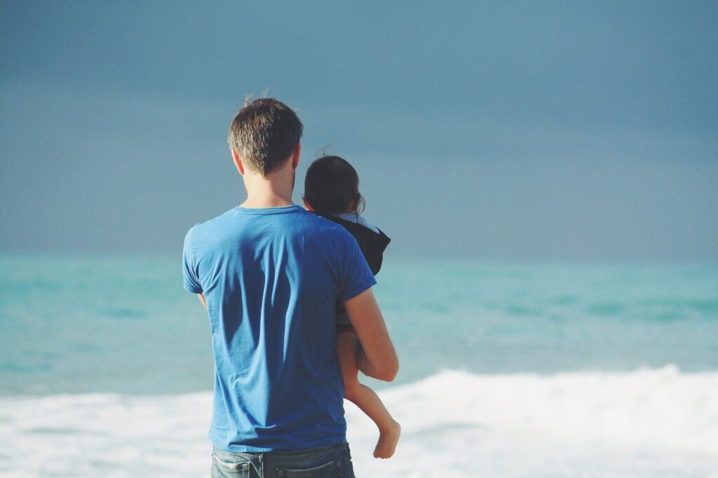 Man holding child at the beach